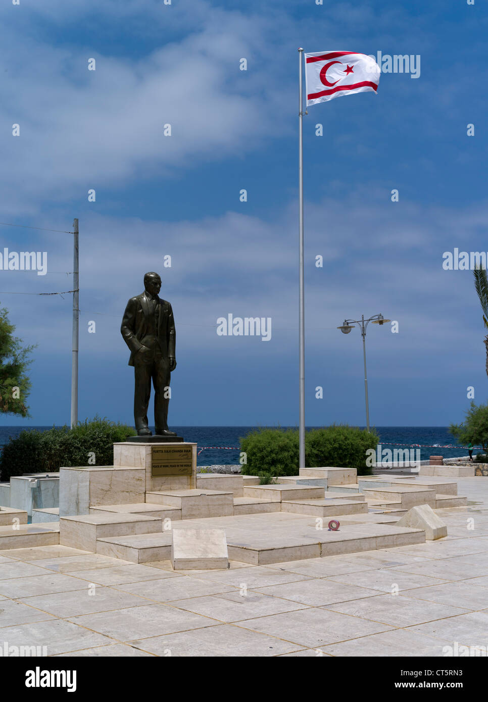dh  KYRENIA NORTHERN CYPRUS Mustafa Kemal Ataturk statue flag Turkish republic of Northern Cyprus - Stock Image
