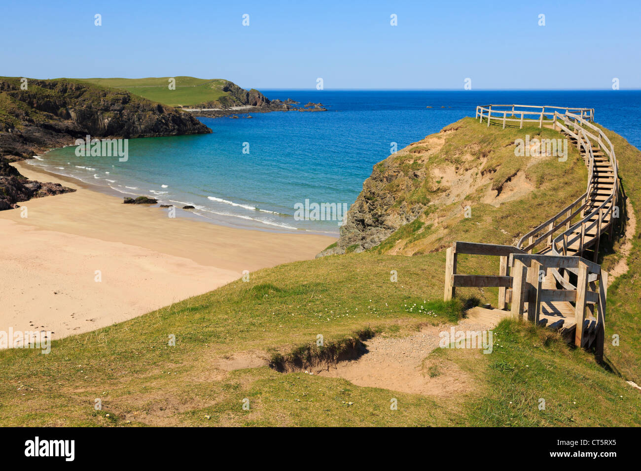 Wooden steps to viewpoint overlooking sandy beach and blue sea on scenic Scottish north coast 500 route at Sango - Stock Image
