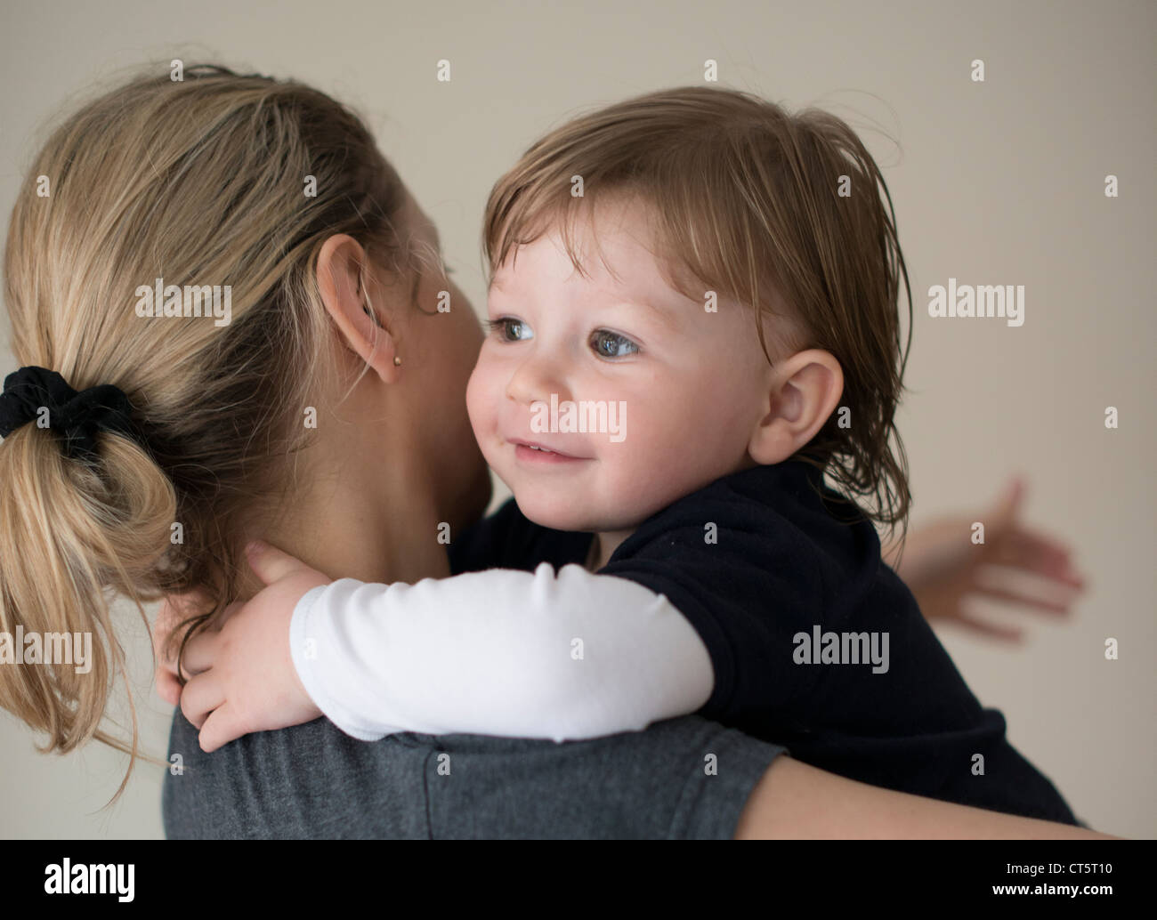 In mother's arms,mother and child - Stock Image