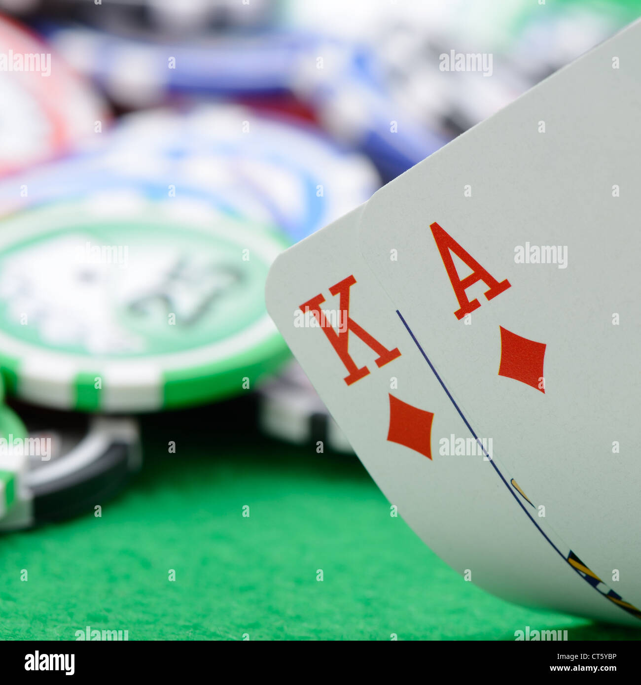 Gaming cards in hand on the green cloth. A winning combination in Black Jack - Stock Image
