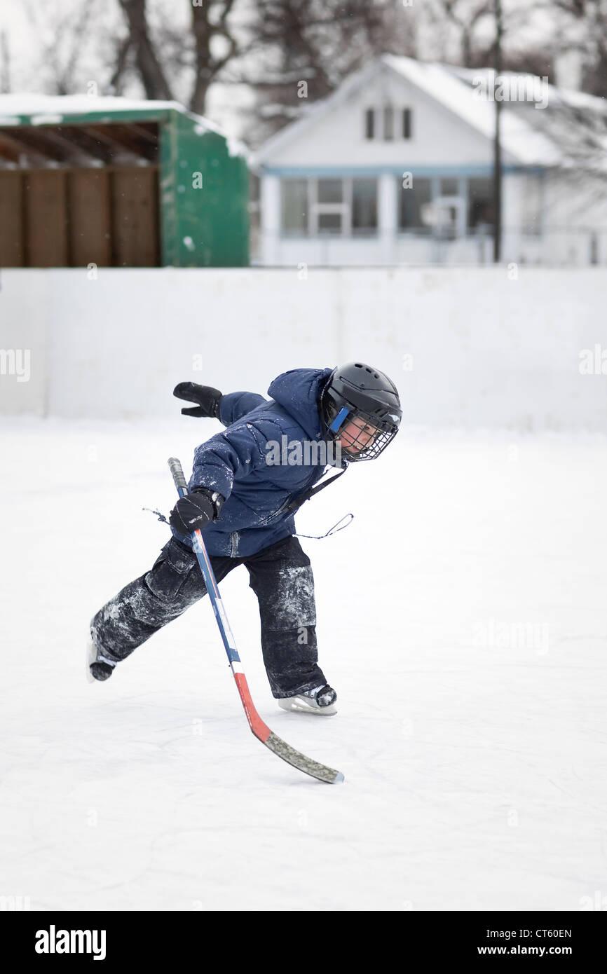 Boy learning to ice skate, Winnipeg, Manitoba, Canada - Stock Image
