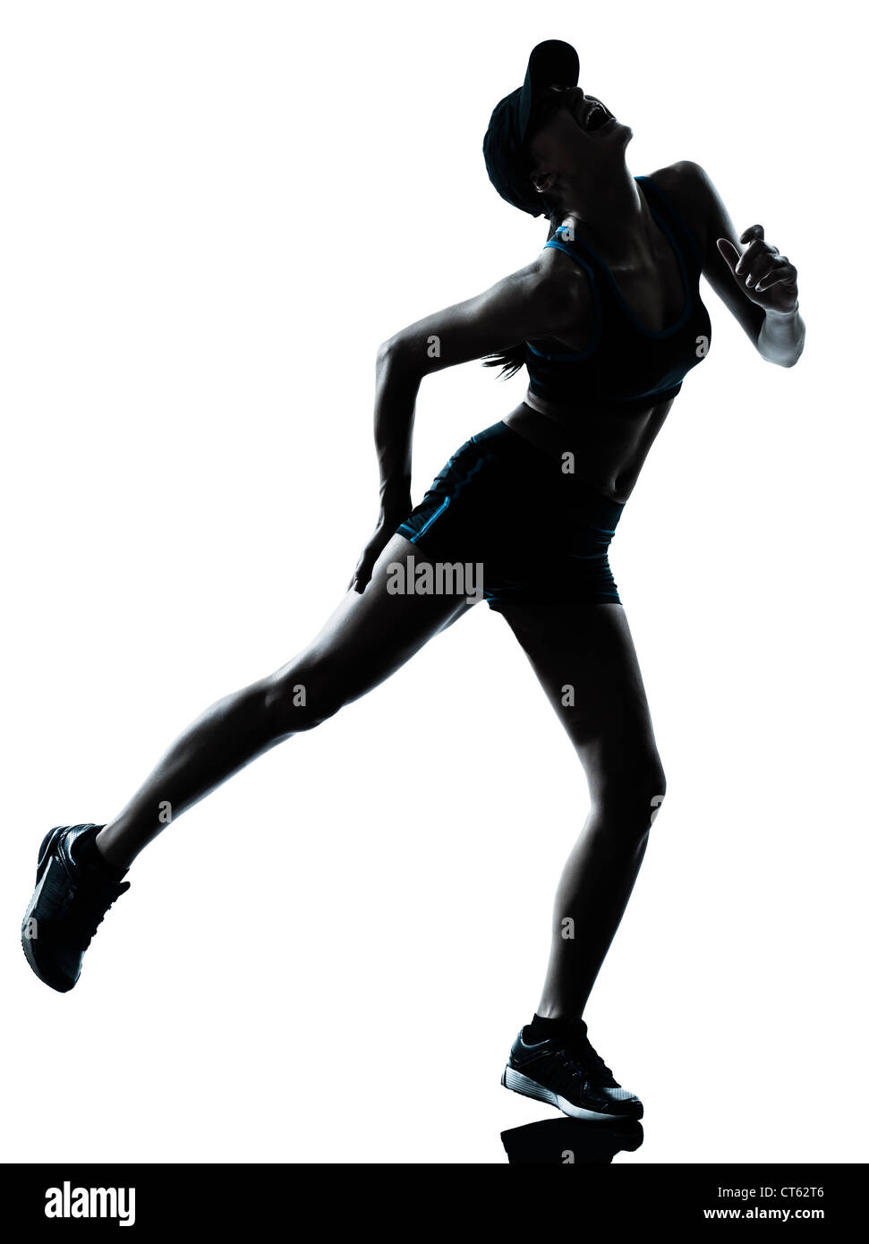 one caucasian woman runner jogger muscle strain cramp physical injury at legs in silhouette studio isolated on white - Stock Image