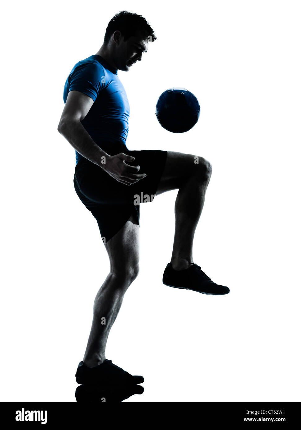 one caucasian man playing soccer football player silhouette  in studio isolated on white background - Stock Image