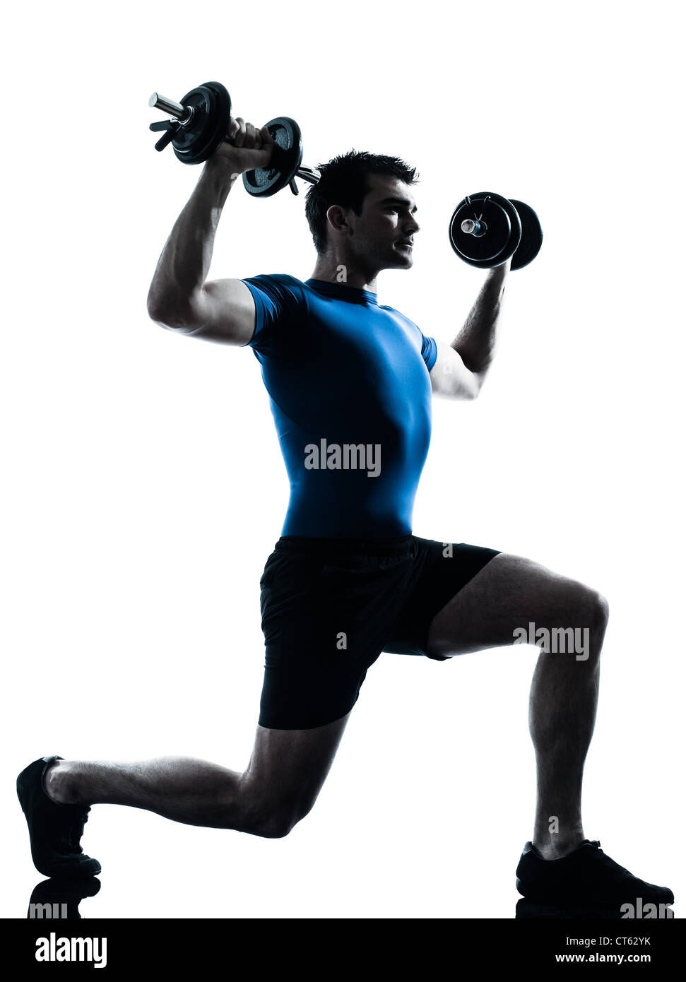 one caucasian man exercising weight training workout fitness in silhouette studio  isolated on white background - Stock Image