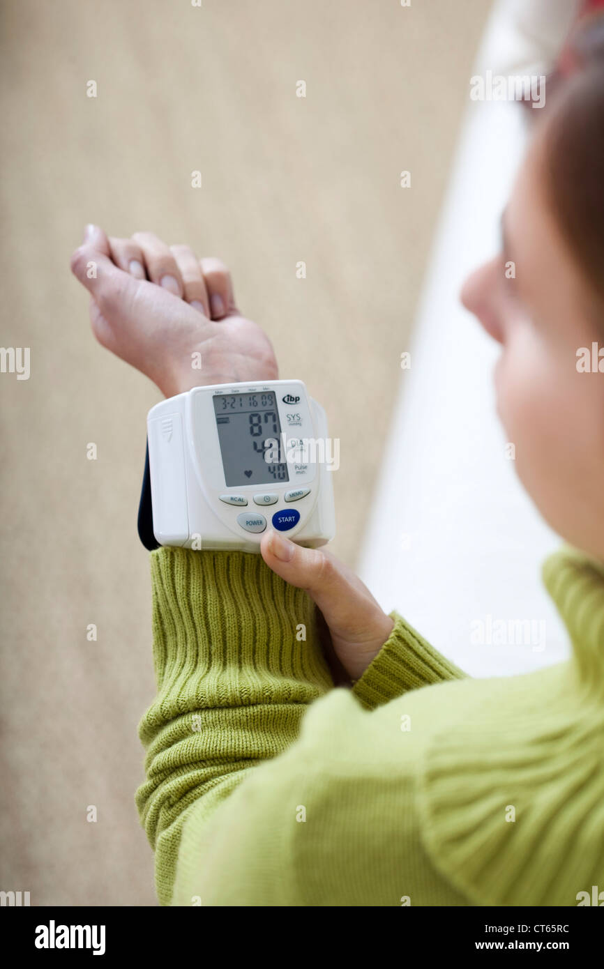 WOMAN WITH LOW BLOOD PRESSURE - Stock Image