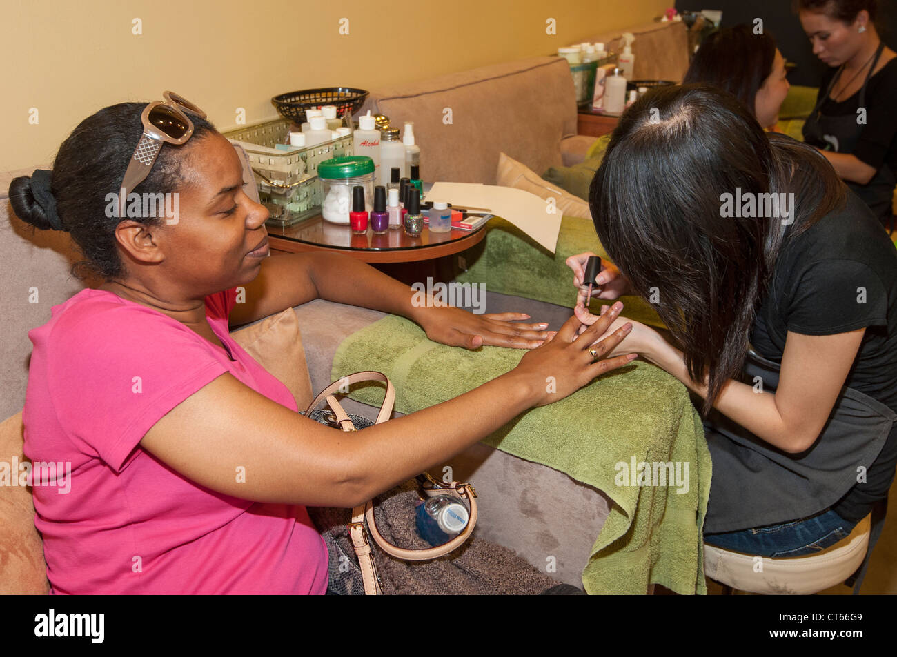 Women getting their nails done at a spa and salon. - Stock Image