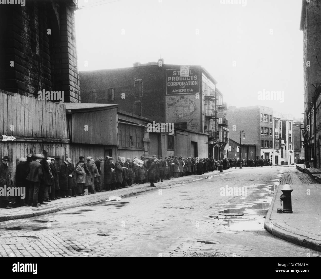 Men waiting on a bread line, New York City - Stock Image