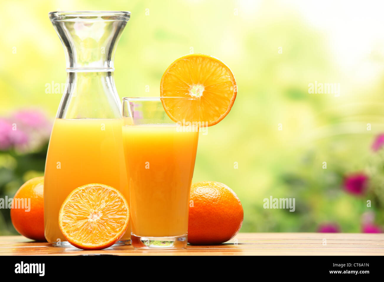 Two glasses of orange juice and fruits - Stock Image