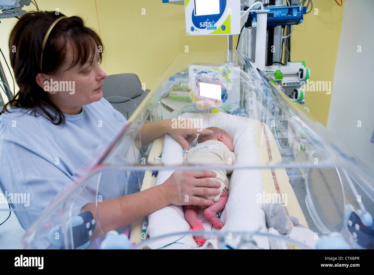 MOTHER AND PREMATURE BABY Stock Photo