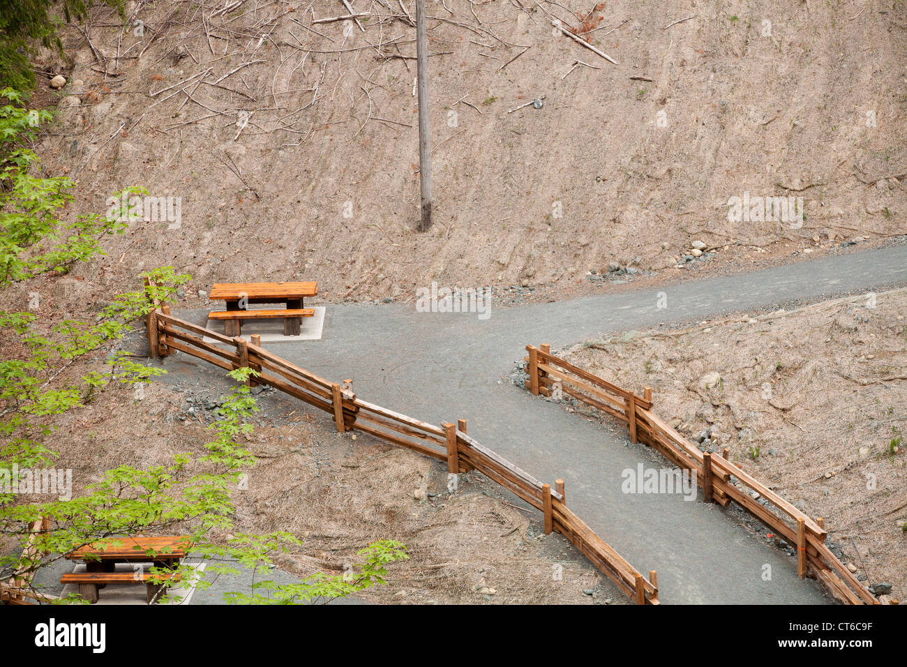 A picnic table sits on a lonely trail. - Stock Image