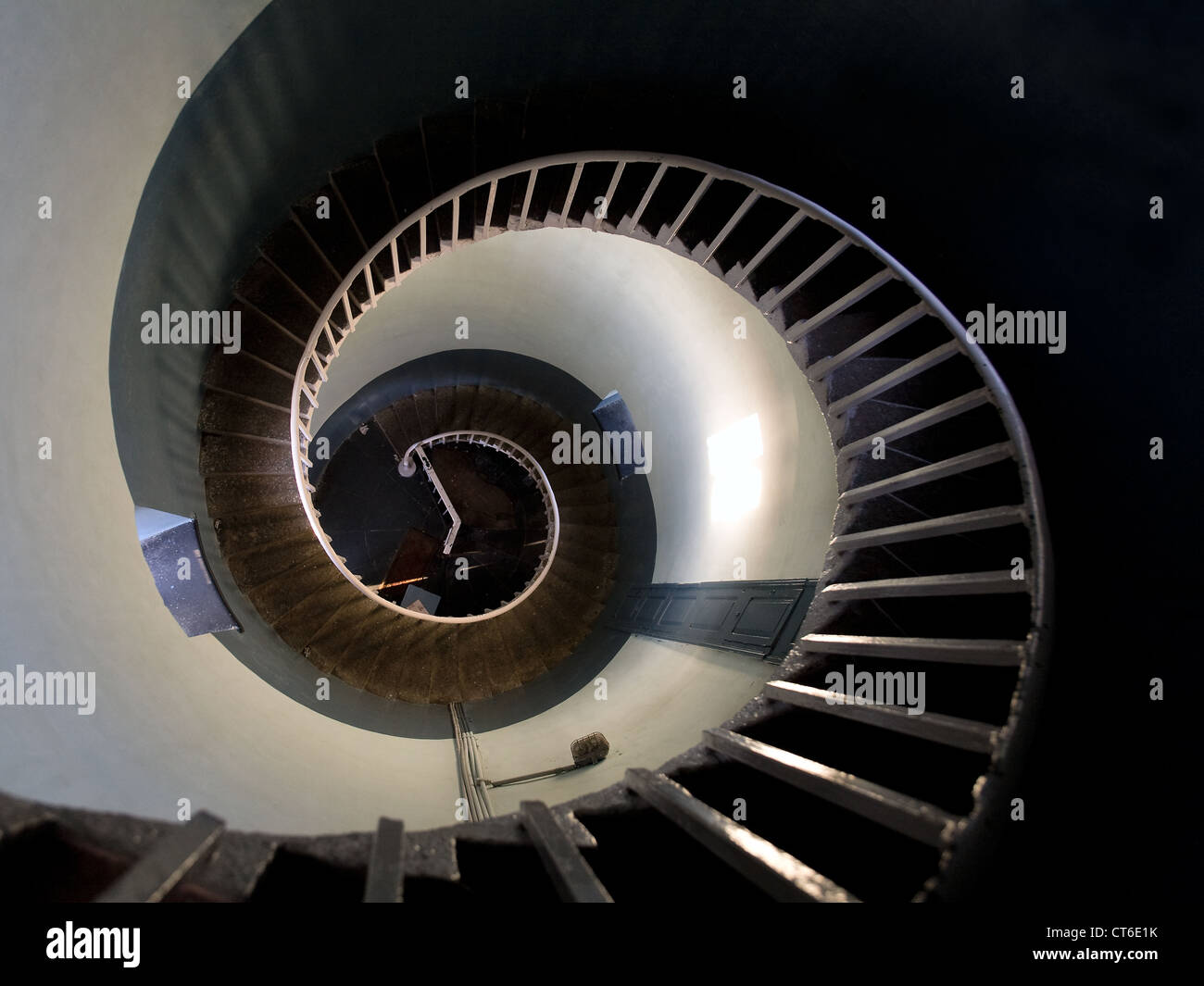 Upside view into the spiral of a lighthouse in Mamalipuram, India - Stock Image