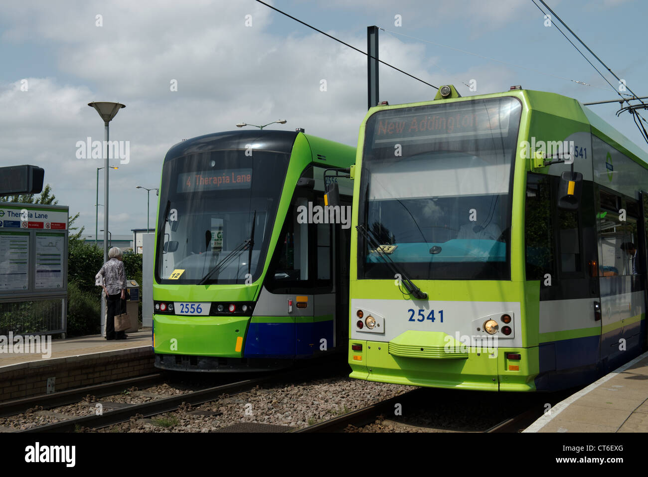 Old and New Croydon Trams at Therapia Lane Stop -1 - Stock Image