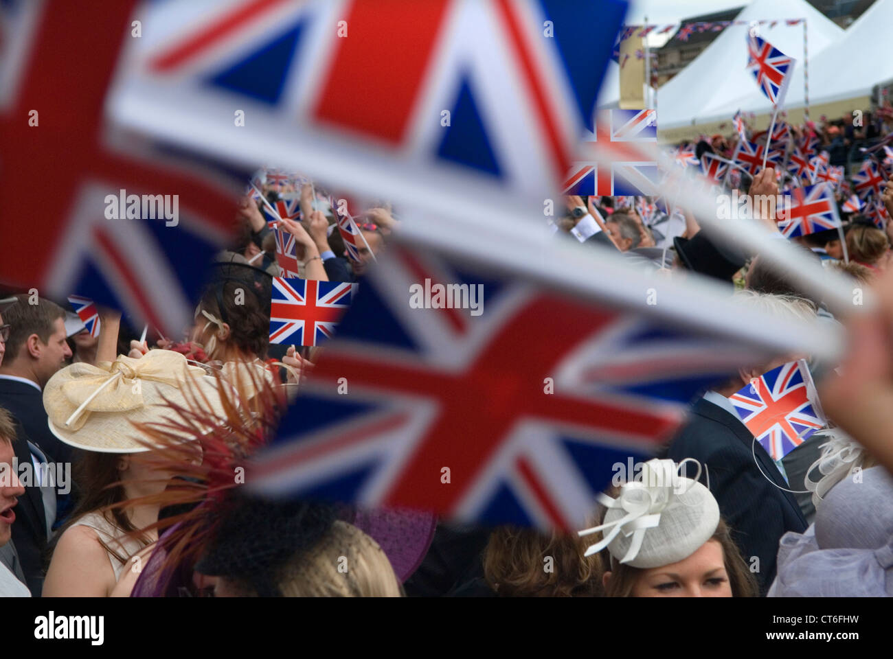 """Royal Ascot singing """"Land of Hope and Glory"""" around the band stand at the end of the days  horse racing Ascot HOMER Stock Photo"""