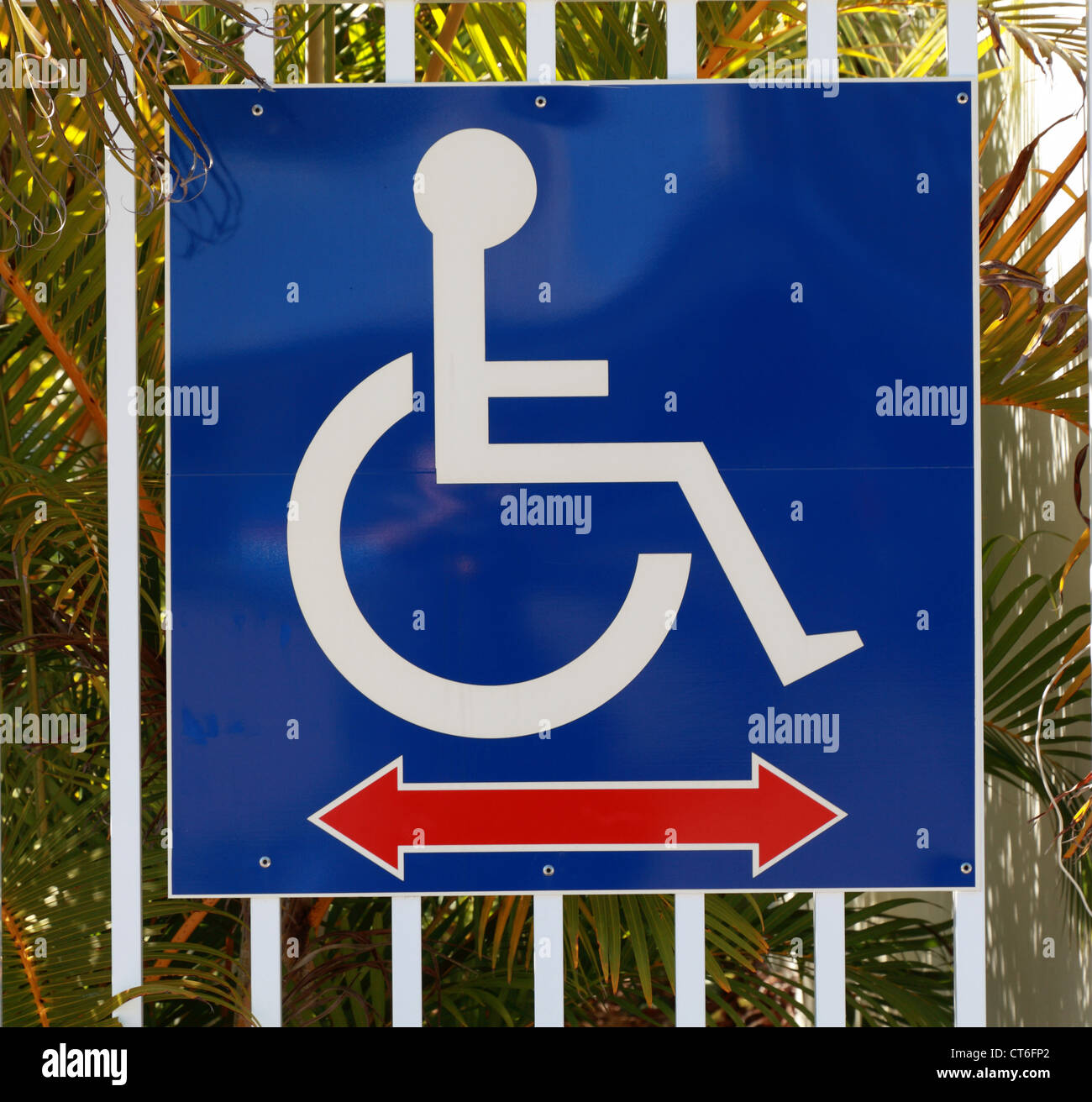 Disabled pictograph sign indicating a direction - Stock Image