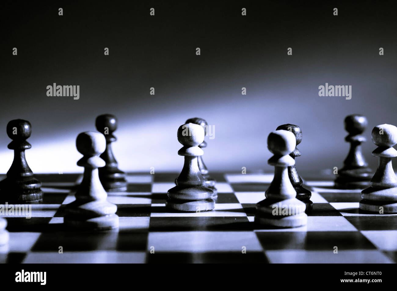 chess pawns on the chessboard - Stock Image