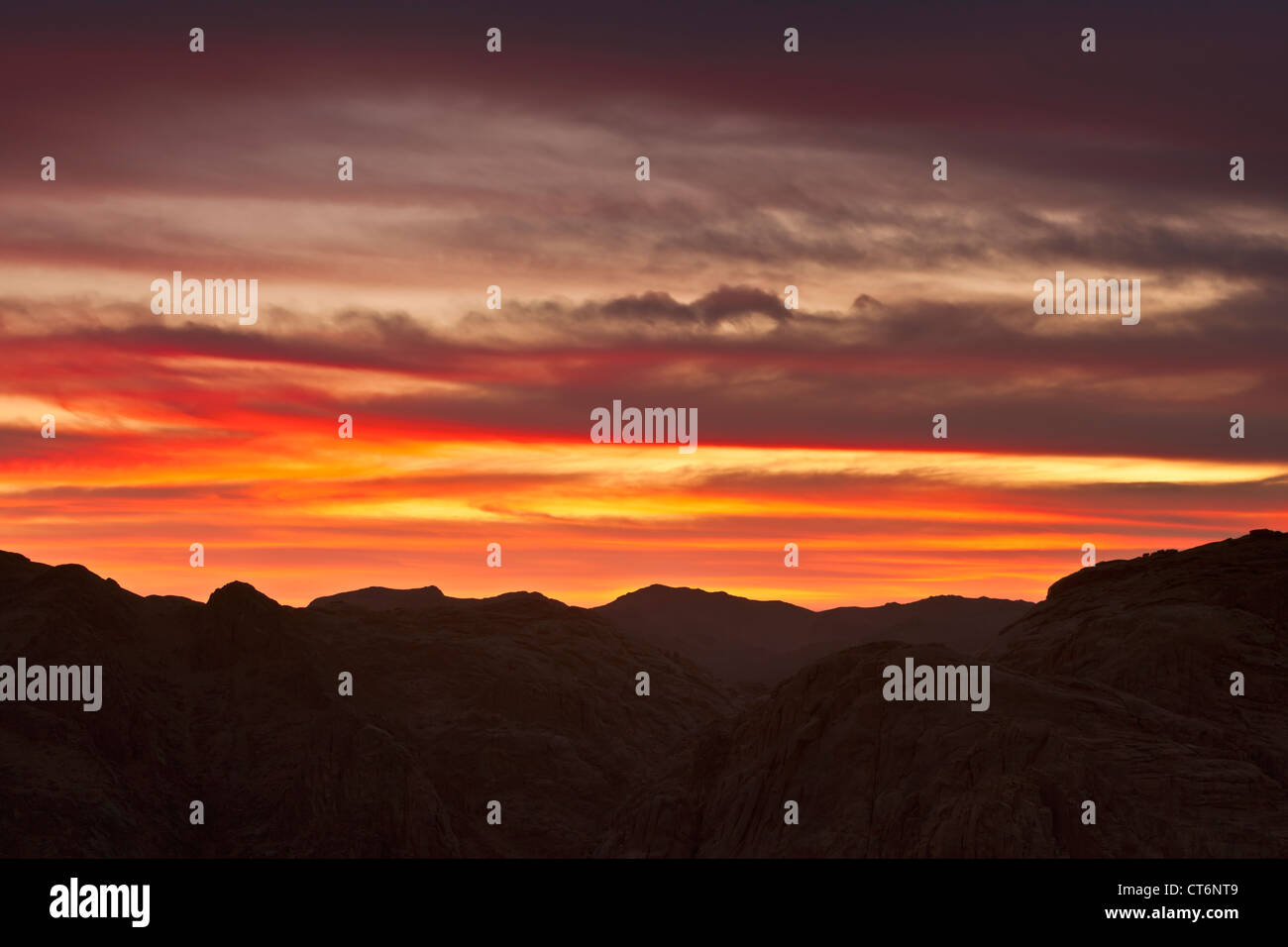 Sunset through clouds from the top of Mount Sinai, Egypt - Stock Image