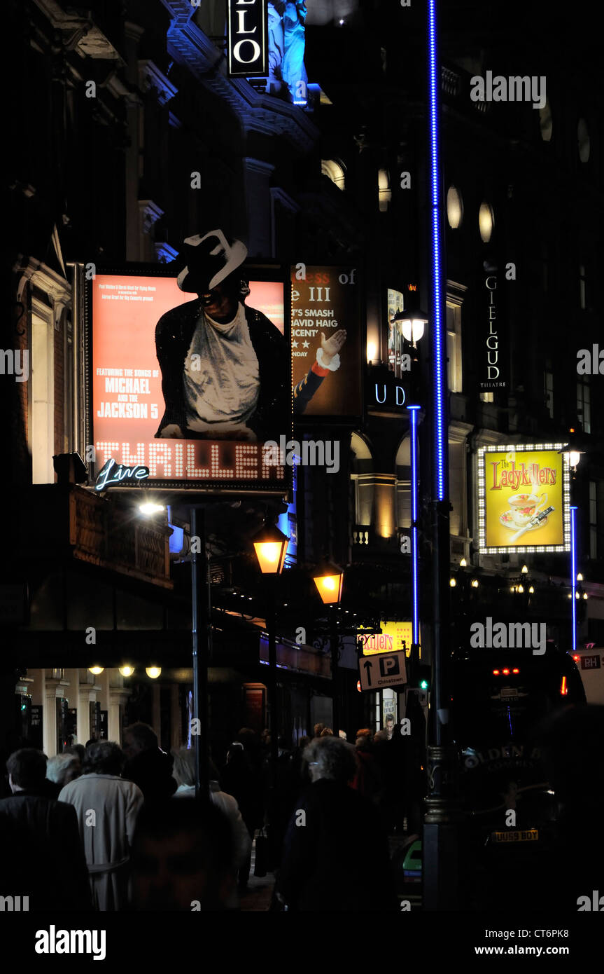 Signs outside of the Apollo and Gielgud theatres on Shaftesbury Avenue, London. - Stock Image