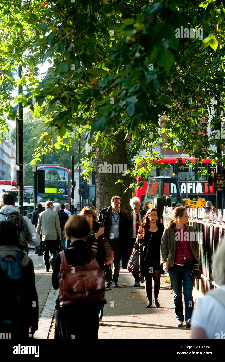 Pedestrians walking along a busy street in the centre of the city of London, England. - Stock Image
