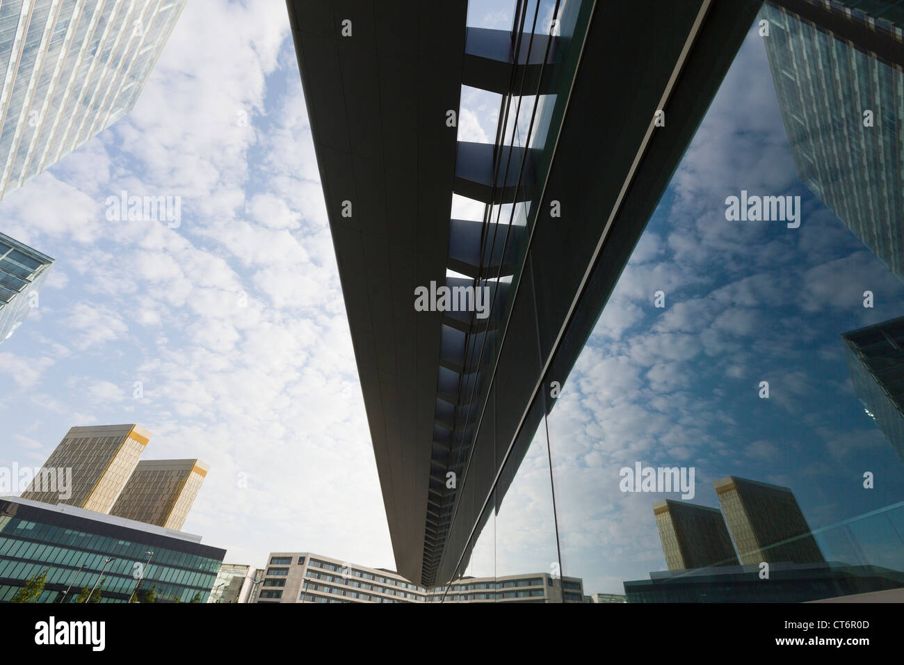 Mirror image of towers with offices of the european court of justice in the windows of the new Kirchberg conference - Stock Image