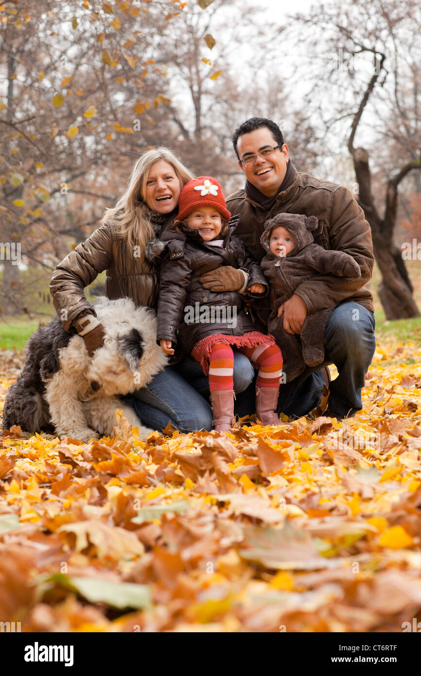 A family enjoying time together in a park during the Autumn season. - Stock Image