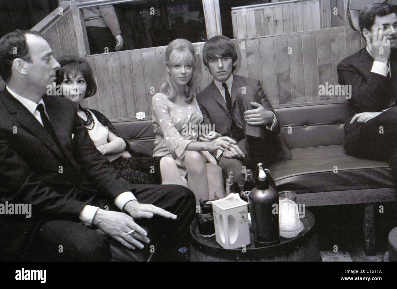 006130 - George Harrison & Pattie Boyd in the Saddle Room, London in 1964 Stock Photo
