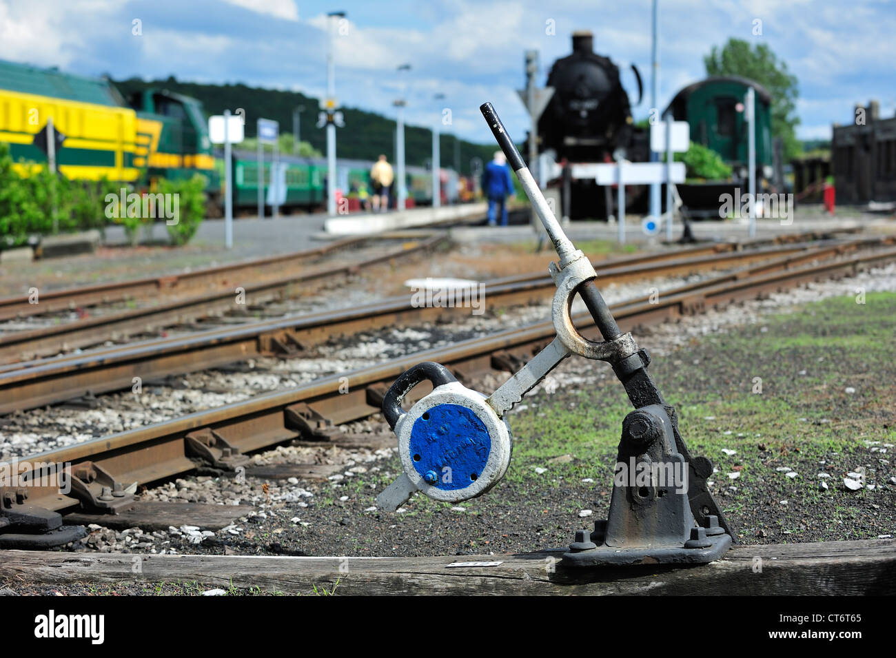Steam train and track switch levers at the depot of the Chemin de Fer à Vapeur des Trois Vallées at Mariembourg, - Stock Image