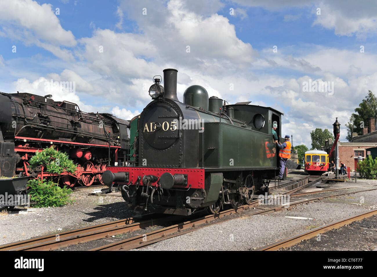 Steam trains at the depot of the Chemin de Fer à Vapeur des Trois Vallées at Mariembourg, Belgium - Stock Image