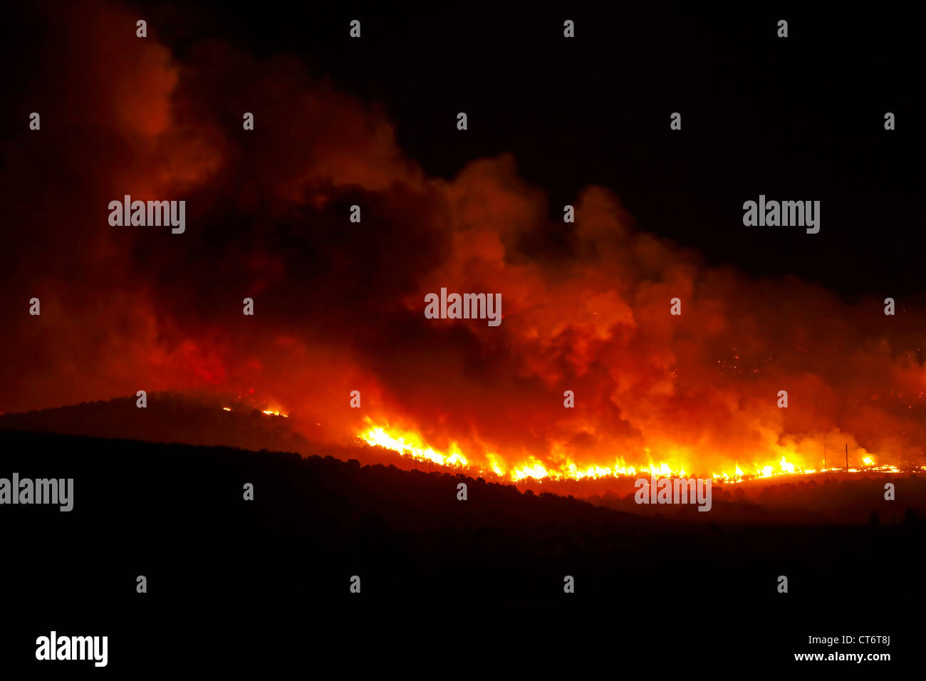 Wildfire rages out of control and burns hills in central Utah. - Stock Image