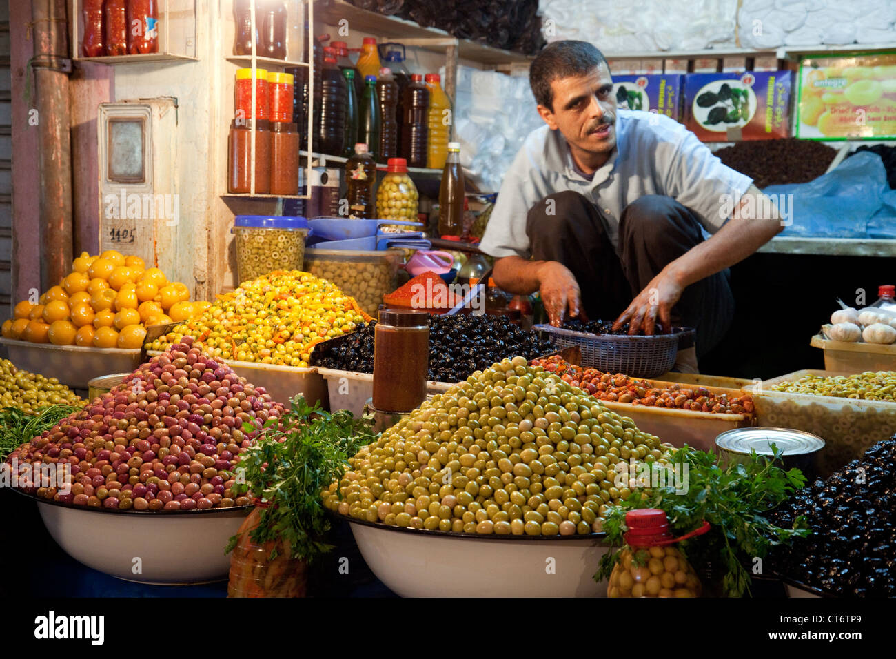 A an selling olives in the market souk, the Medina, Taroudant, morocco Africa Stock Photo