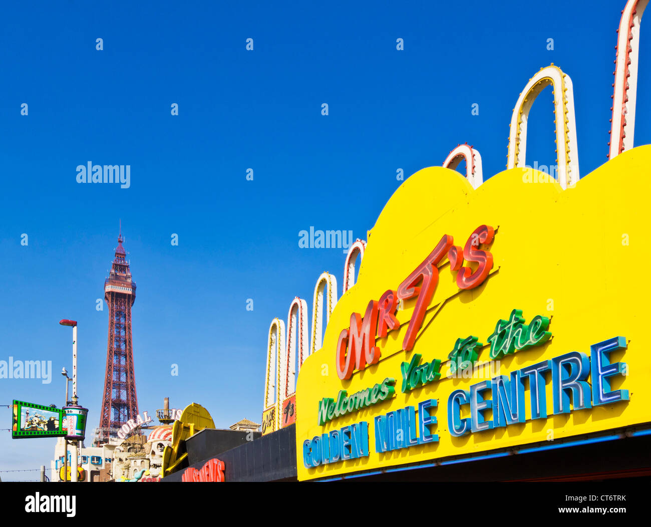 Blackpool tower and seafront amusements Mr t's Golden mile centre  along the Golden Mile on the seafront Blackpool - Stock Image