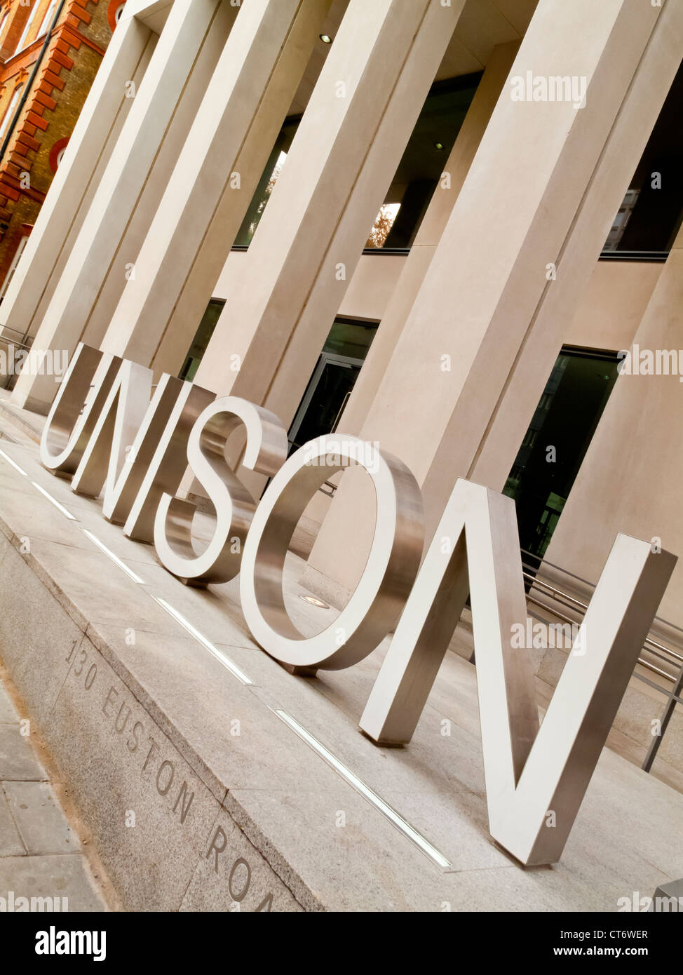 Metal sign outside headquarters of Unison trade union on Euston Road in London.  Unison is the largest trade union - Stock Image