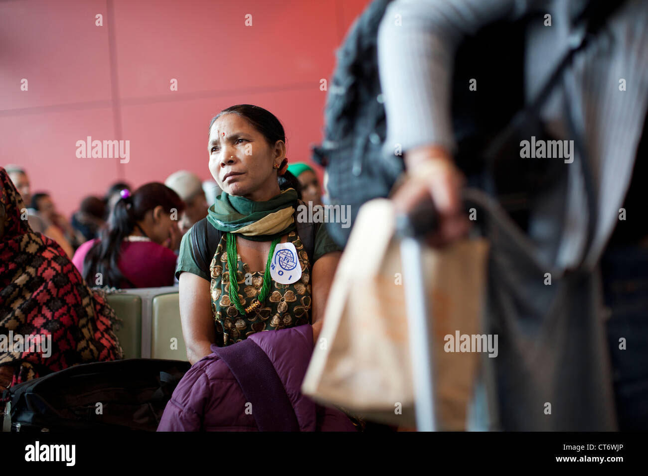 Bhutanese refugees of Nepali origin wait for an IOM sponsored flight to the U.S. at London, England's Heathrow Airport. Stock Photo