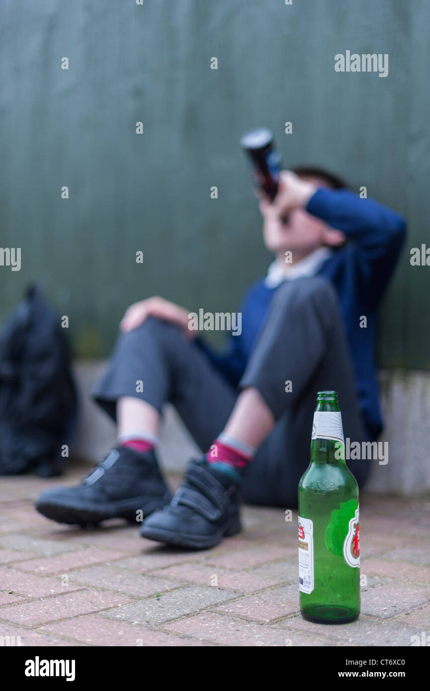 A posed 12 year old boy showing the problems of underage drinking in the Uk - Stock Image