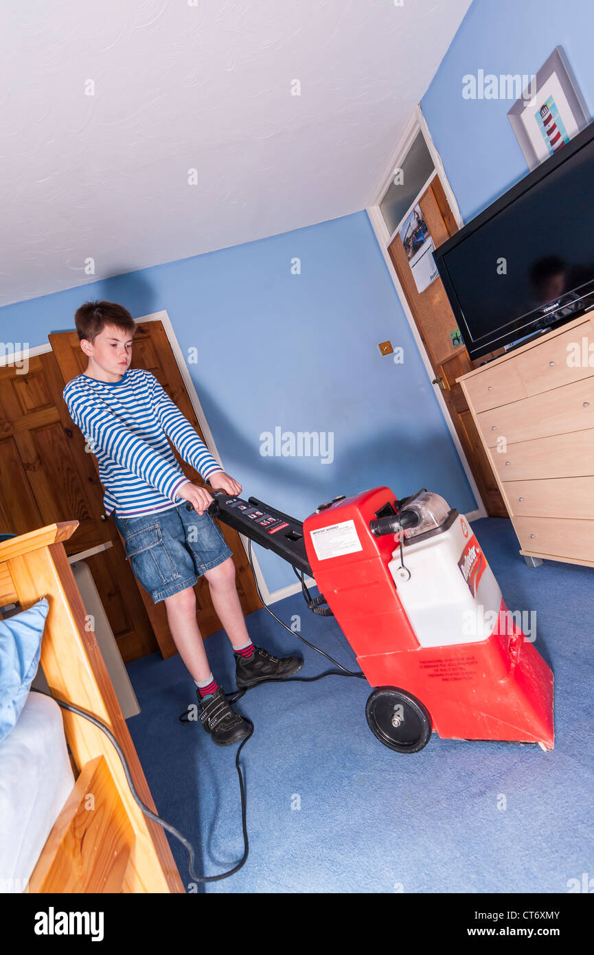 A Boy Cleaning His Bedroom Carpet With A Hired Rugdoctor