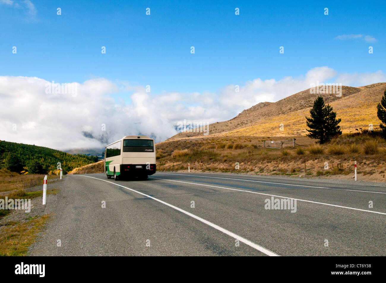 Coach on a quiet road in New Zealand South Island. - Stock Image