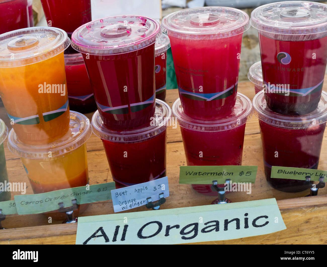 Organic juices on sale at Farmers Market Embarcadero San Francisco California USA - Stock Image