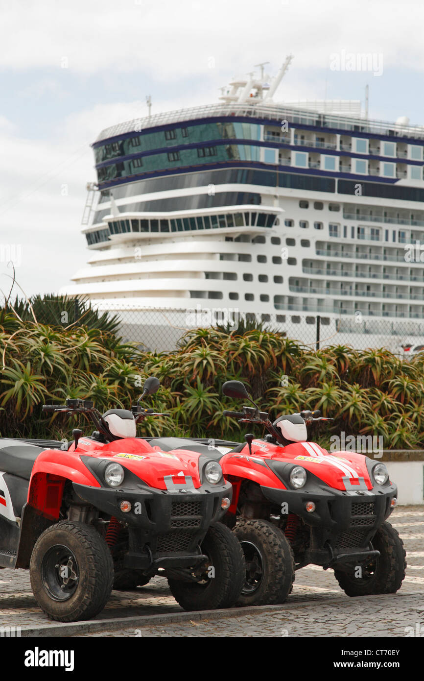 ATV moto quads for rent with cruise ship on the background. Ponta Delgada, Azores, Portugal. - Stock Image