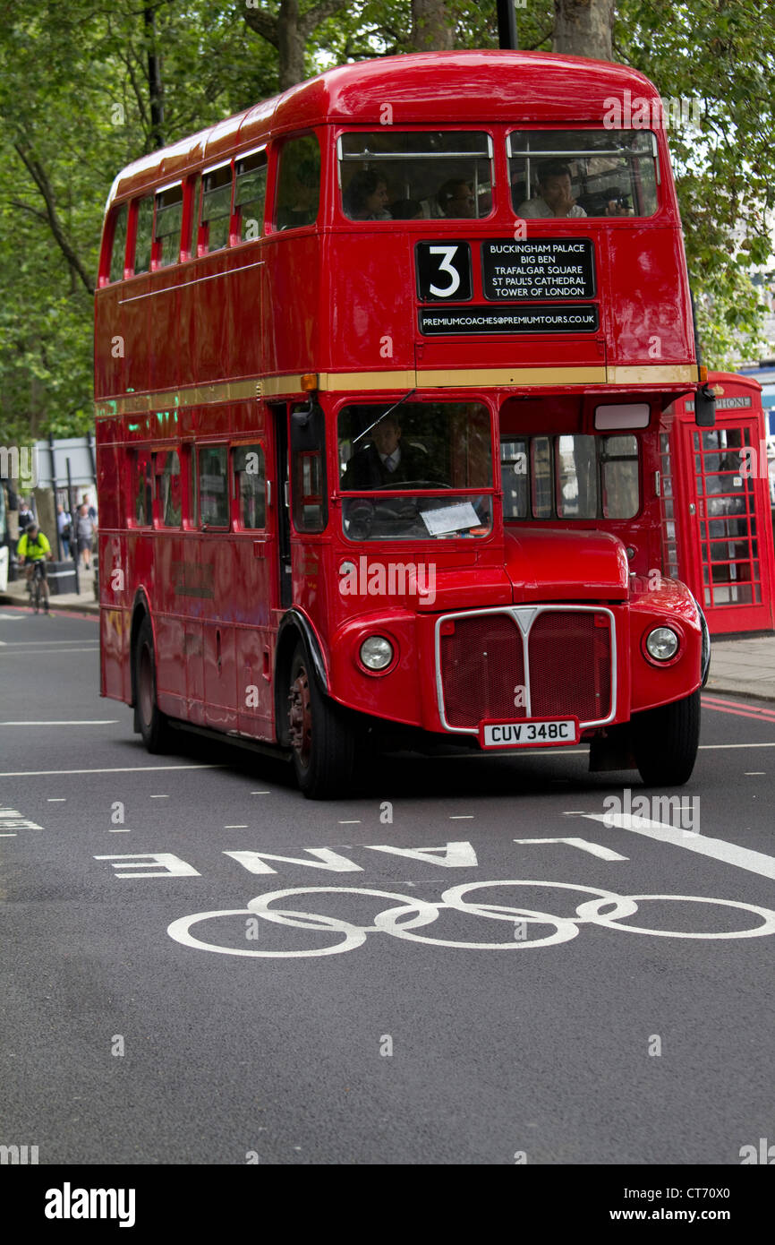 Olympic road traffic lanes Victoria embankment introduced  for London 2012 games with Red London routemaster bus - Stock Image