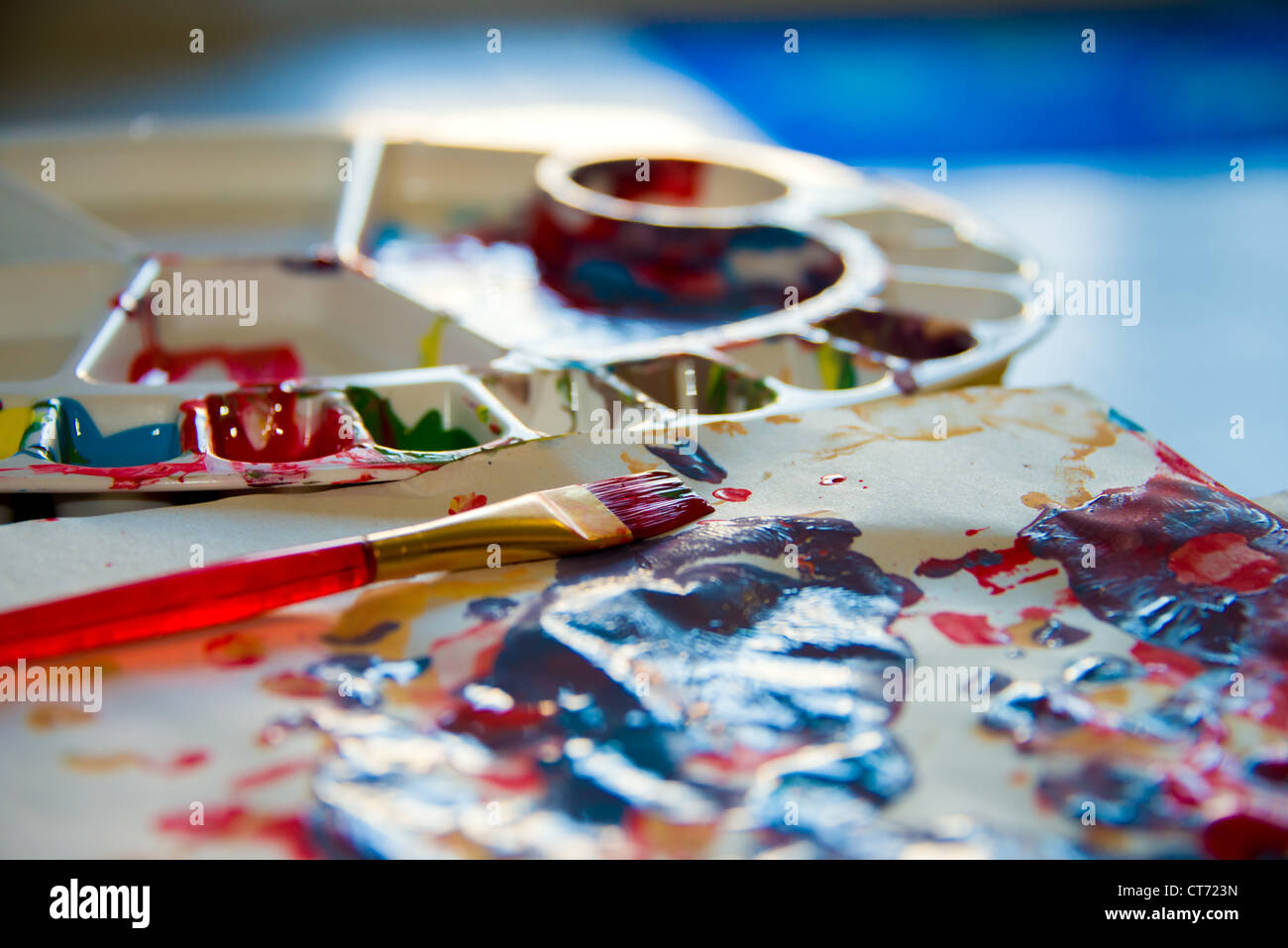 Children's paint palette and brush. - Stock Image