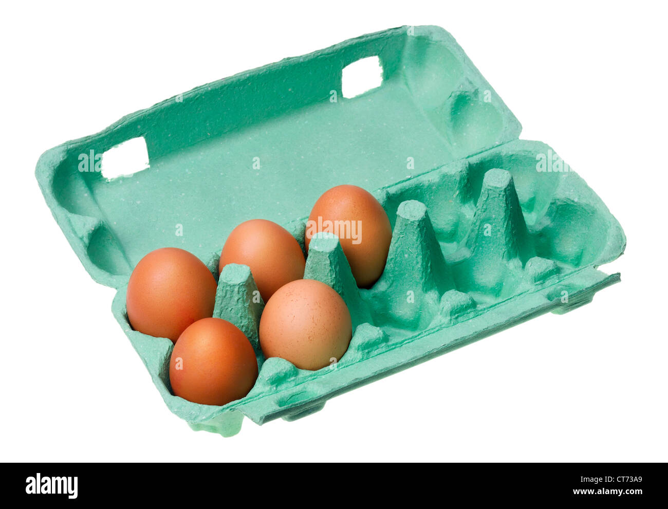 five red raw eggs lie in a green cardboard packaging environment isolated - Stock Image