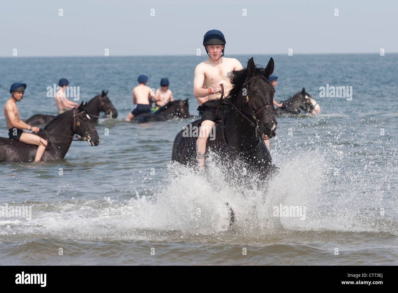 Members of the Blues and Royals (Household Cavalry) exercise their mounts on Holkham Beach in Norfolk Stock Photo