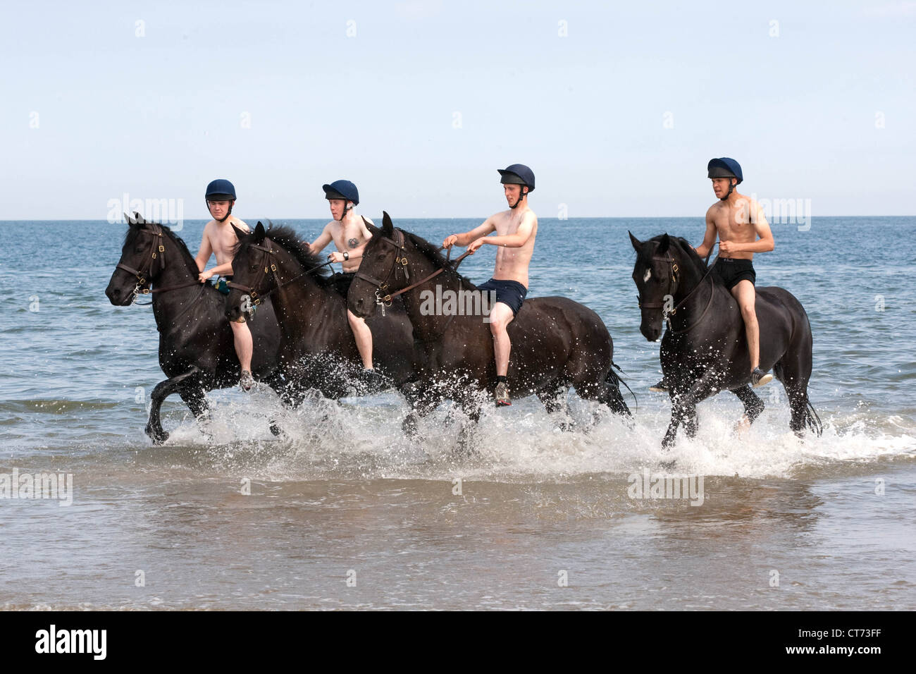 Members of the Blues and Royals (Household Cavalry) exercise their mounts on Holkham Beach in Norfolk - Stock Image