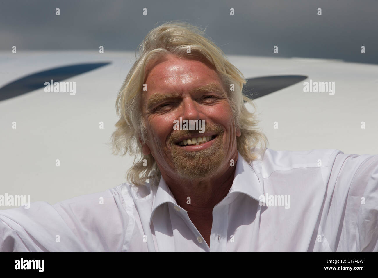 Alongside his SpaceShipTwo vehicle, Richard Branson after Virgin Galactic space tourism presentation at Farnborough - Stock Image