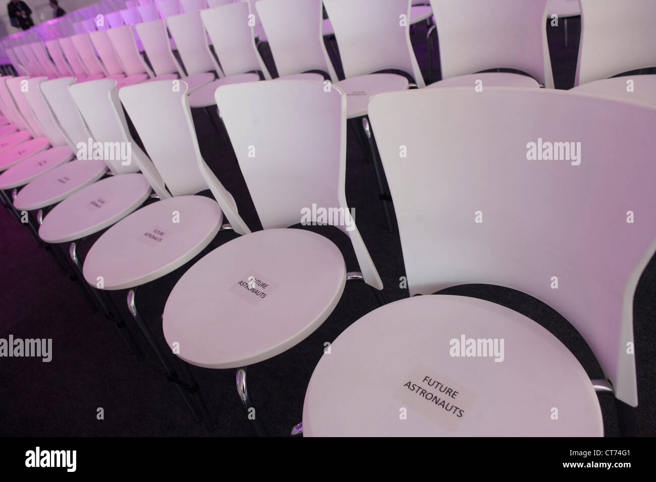 Empty seats to be filled by upcoming astronauts at a PR event by Virgin Galactic. - Stock Image