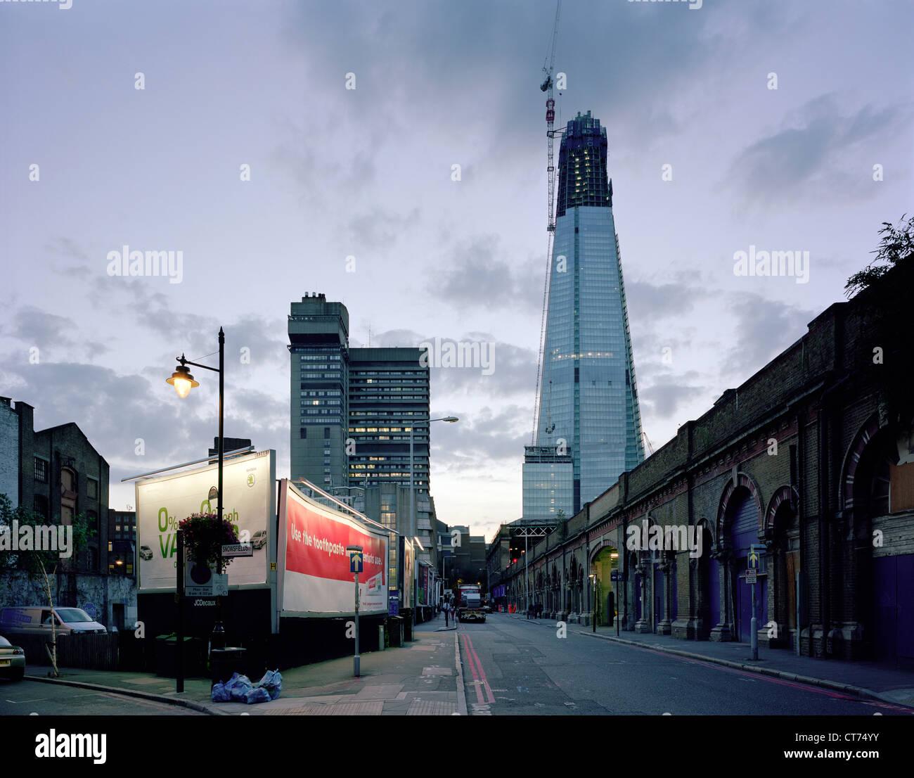 Shard, London, United Kingdom. Architect: Renzo Piano Building Workshop, 2012. Dusk view from St Thomas Street (east). Stock Photo