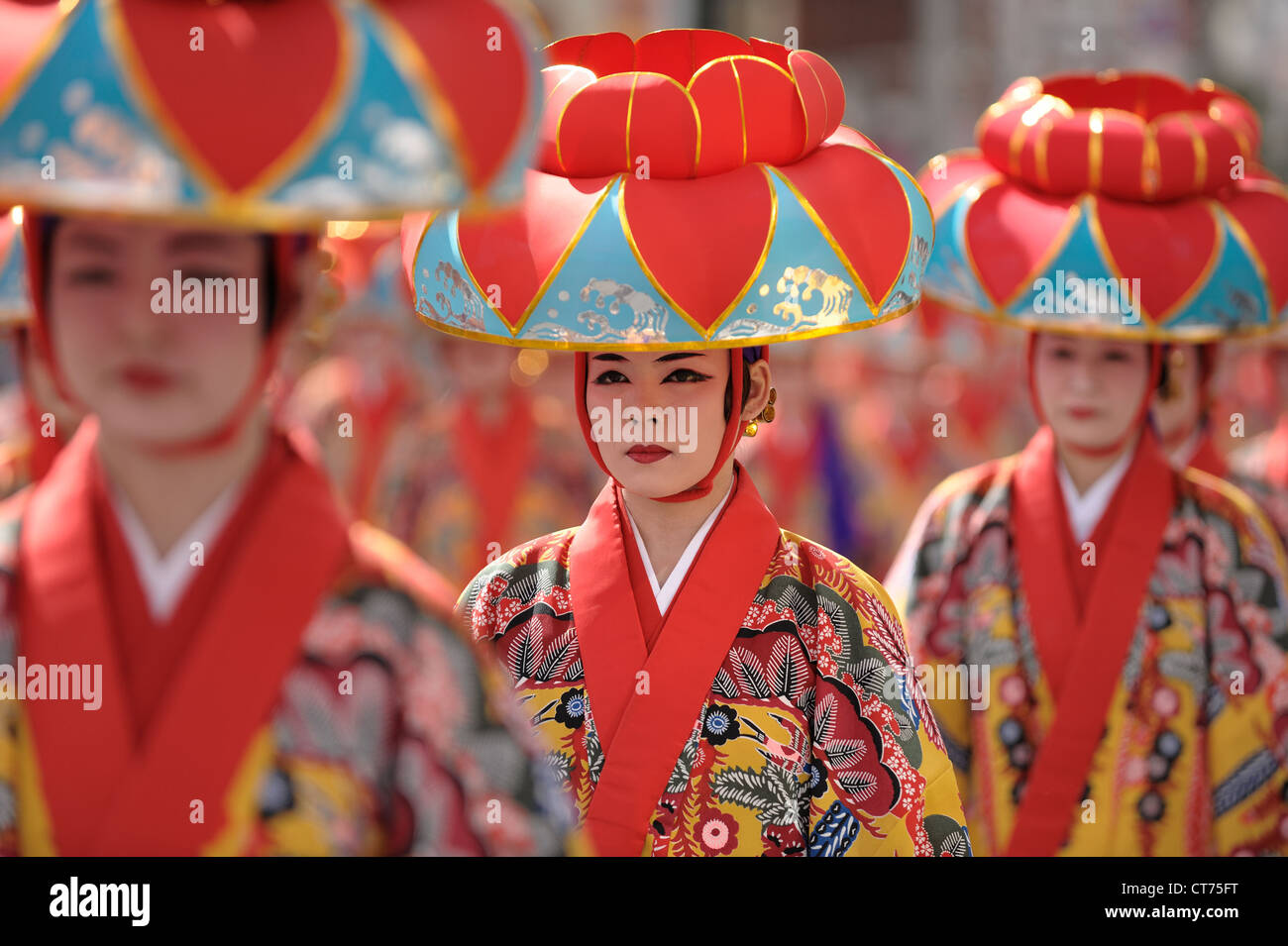 Dance performers make their way to the next location where they will perform during a local festival in Okinawa, - Stock Image