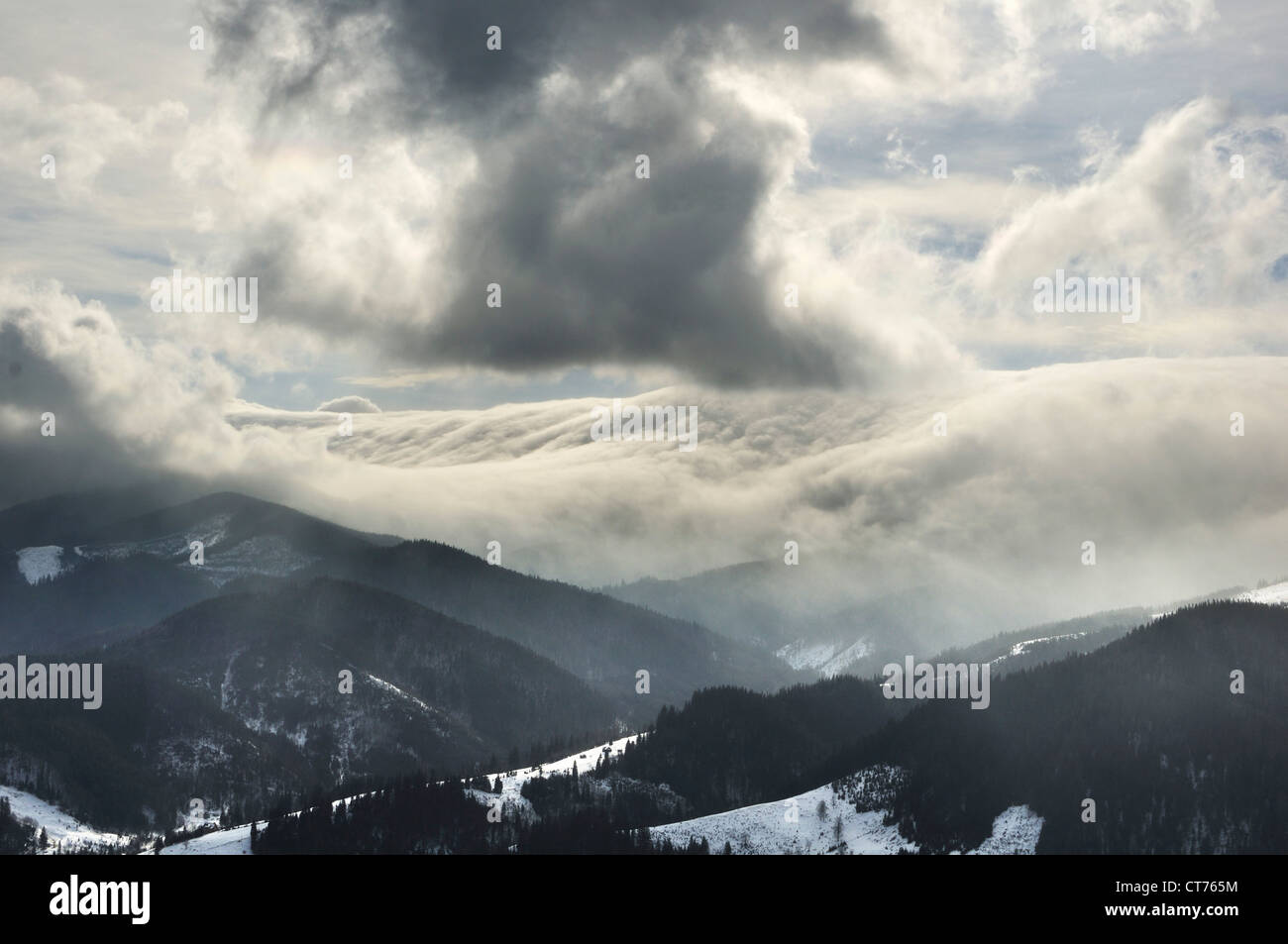 run down hut clouds in Dzembronya landscape in Ukraine Carpathian Mountains - Stock Image