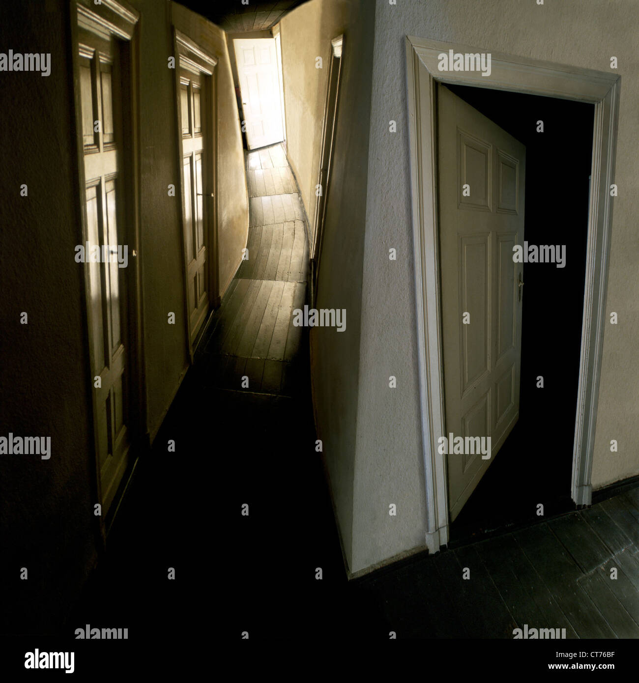 Open and closed doors in a hallway - Stock Image