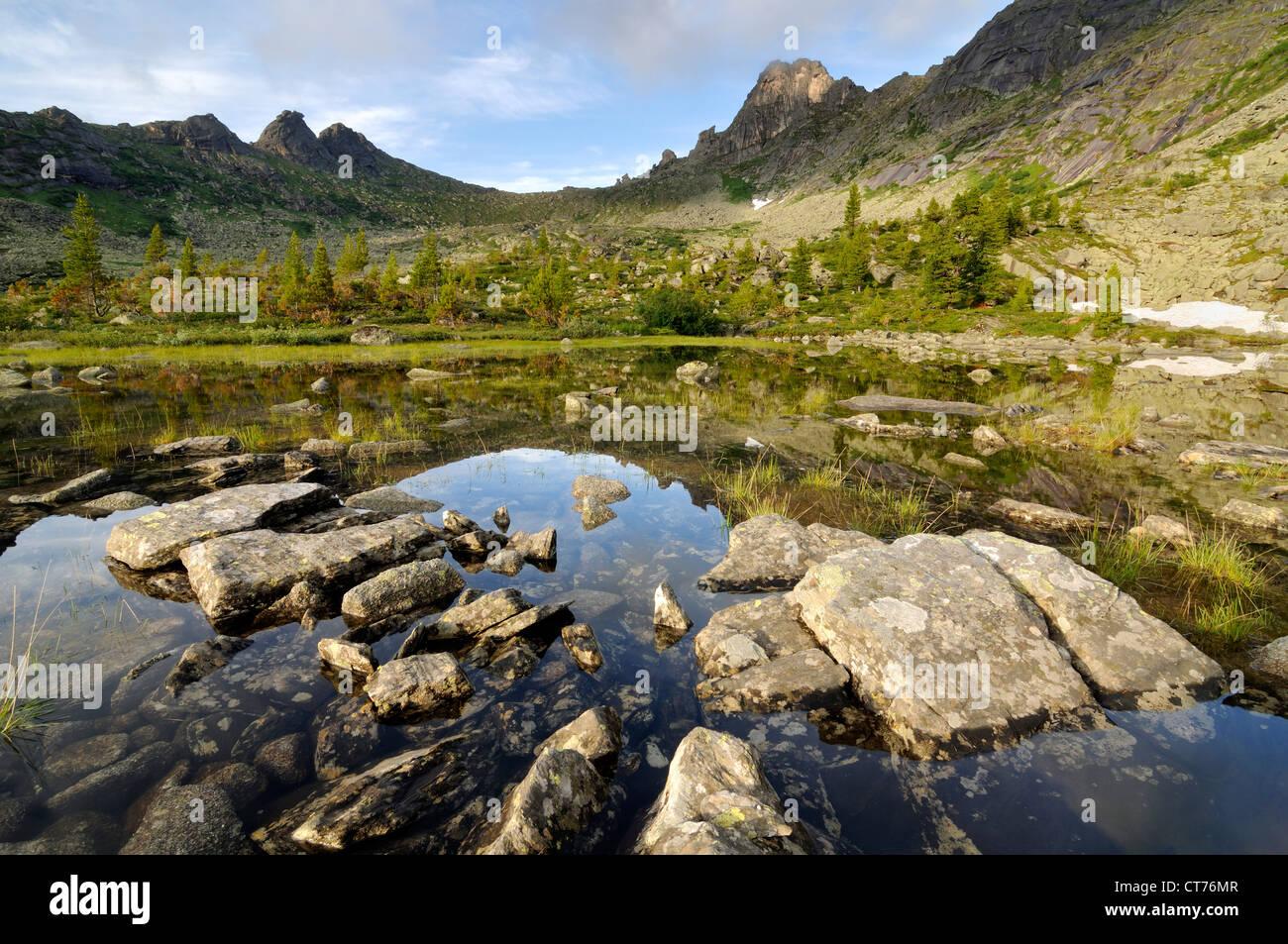 view at hudijnikov pass from nizhneye buibinskoe lake - Stock Image