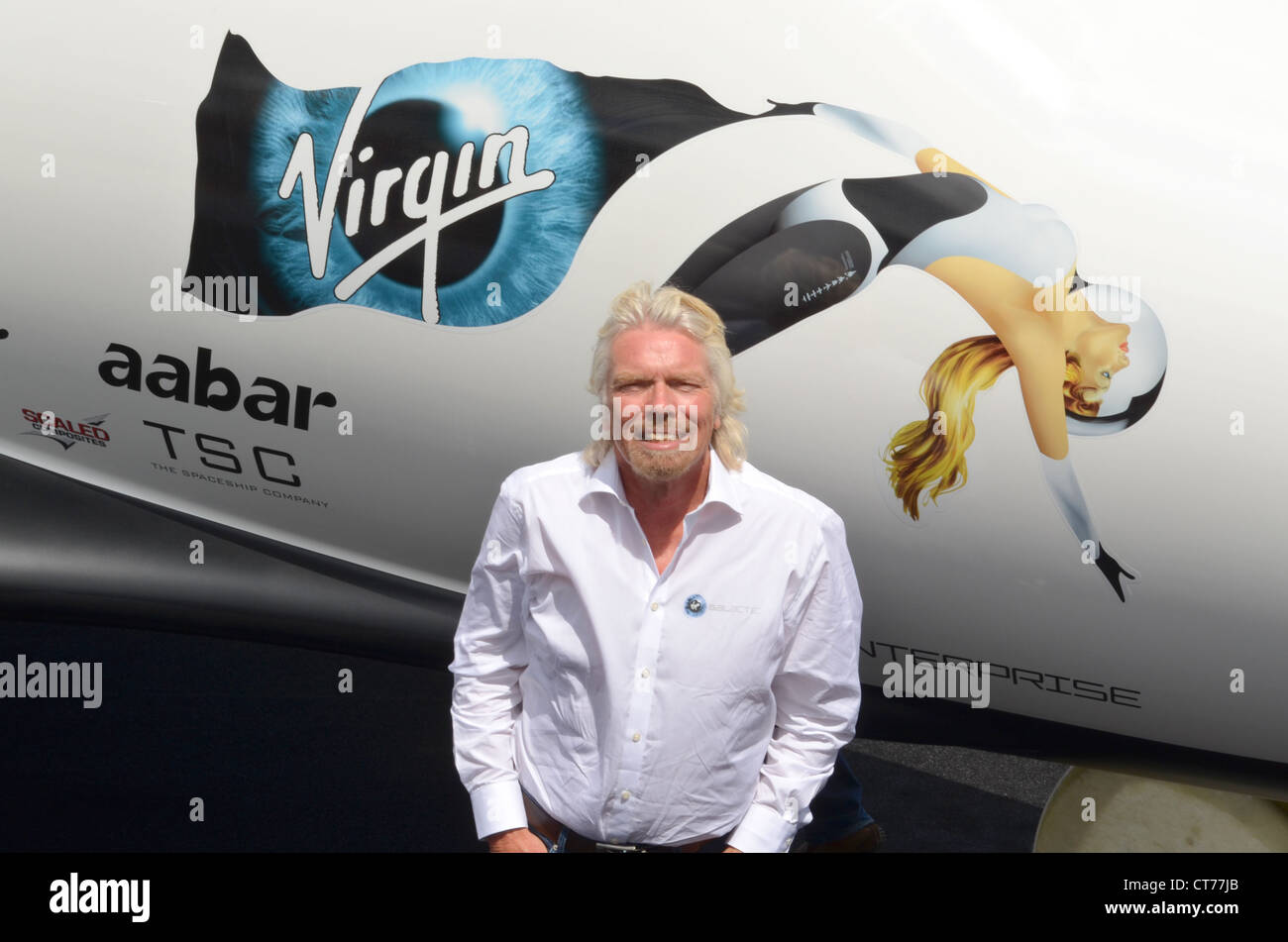 Sir Richard Branson, Founder of Virgin Galactic in front of a replica of SpaceShipTwo unveiled at the Farnborough - Stock Image